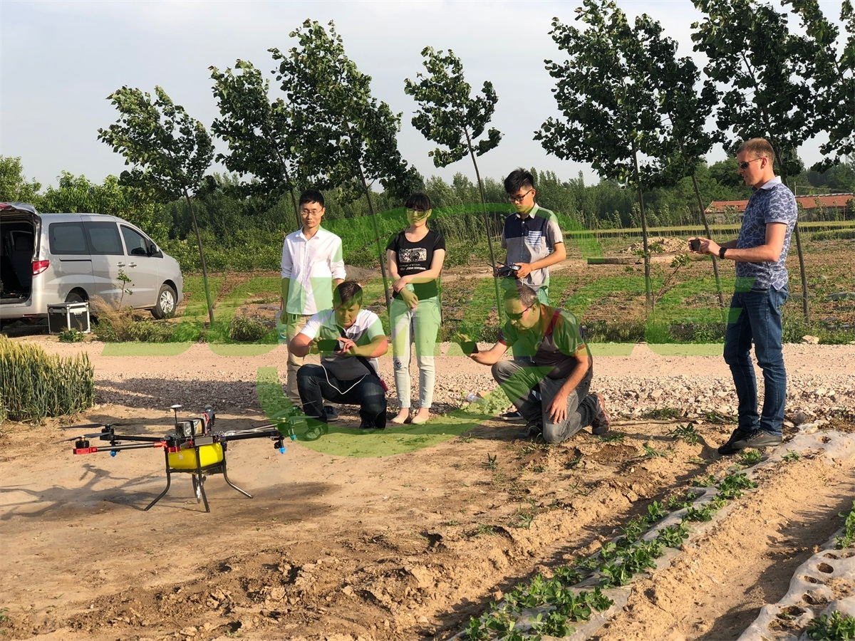 European customers view sprayer drone demo, together with Asian customer