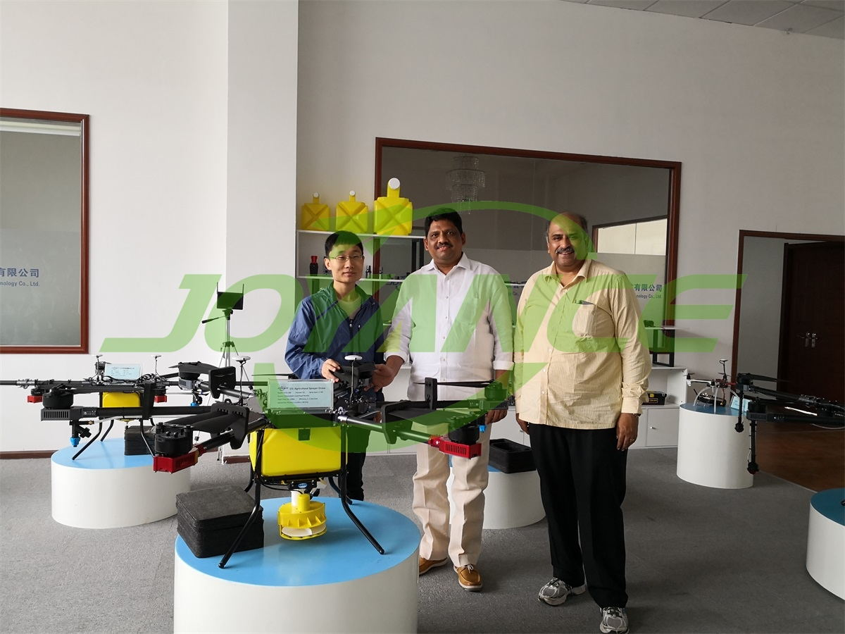 Indian customers view drone spraying demo