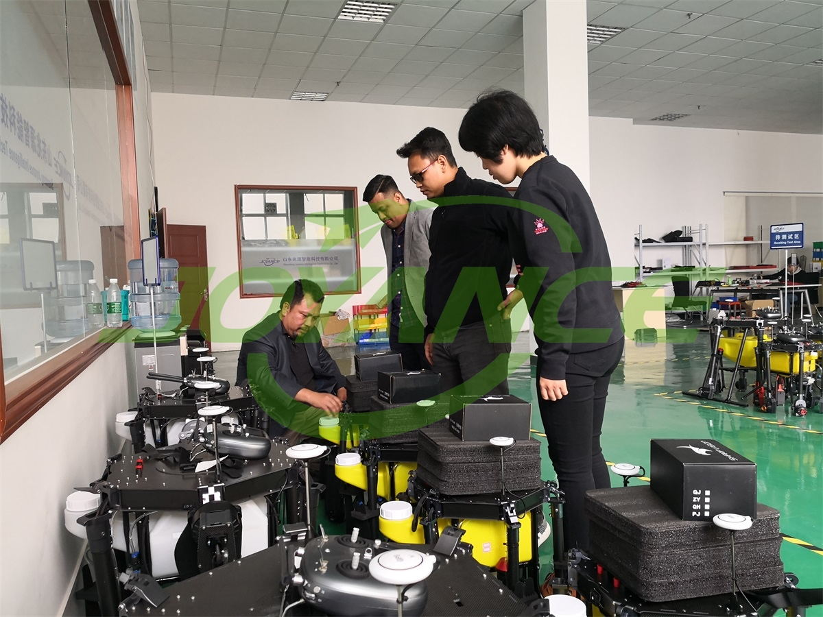 Southeast Asia customers inspect drone sprayers they ordered